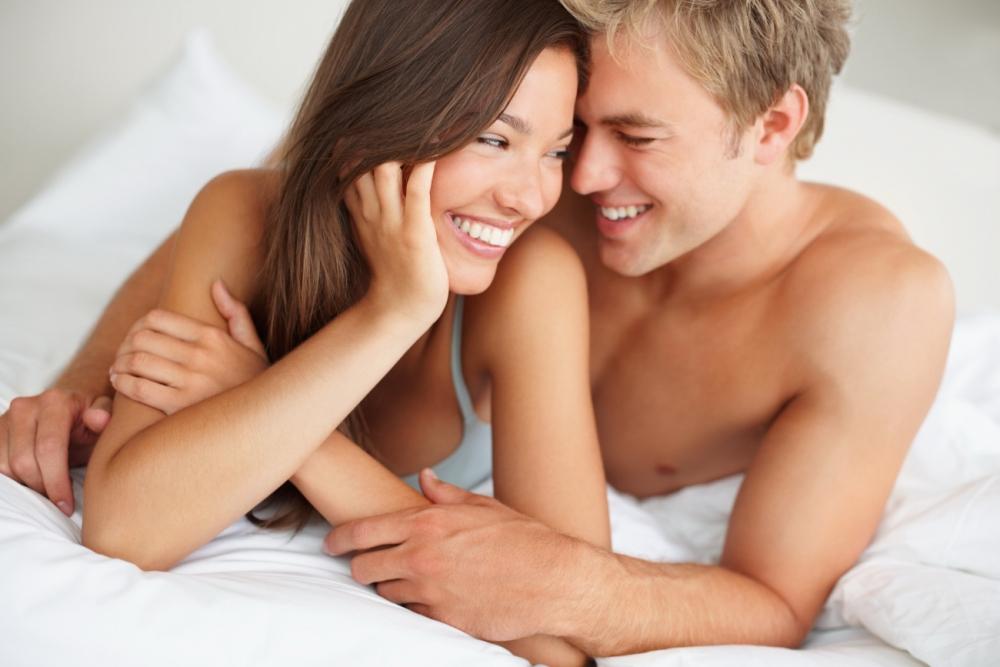 Happy Couple Relaxing in Bedroom