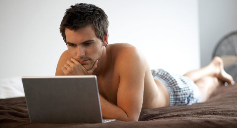 Man in Bed with Laptop Photo