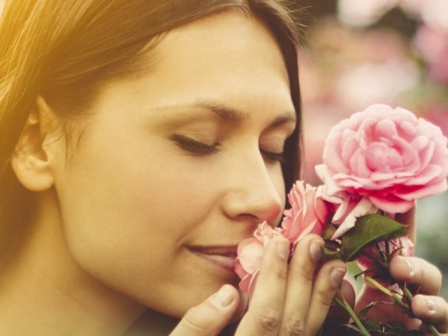 Woman Smelling Pink Roses