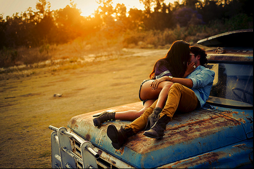 couple kissing on truck