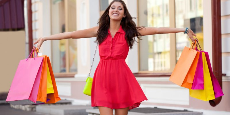 woman in red dress happy shopping