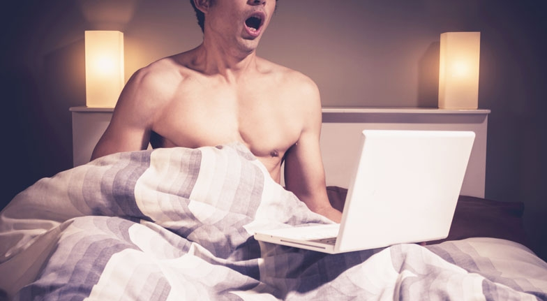 male shocked by laptop